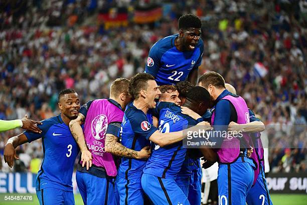Antoine Griezmann of France of France celebrates his second goal with team mates during the Uefa Euro Semi final between France and Germany at Stade...