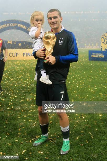 Antoine Griezmann of France poses with his daughter and the trophy after the 2018 FIFA World Cup Russia Final between France and Croatia at the...
