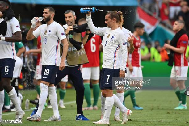 Antoine Griezmann of France pours water on his head during the drinks break in the UEFA Euro 2020 Championship Group F match between Hungary and...