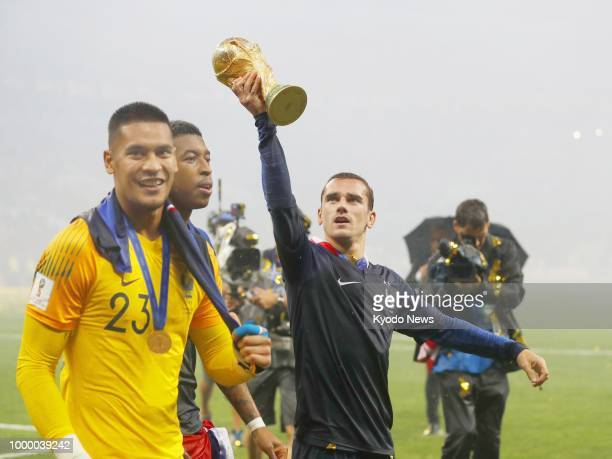 Antoine Griezmann of France raises the World Cup trophy after France beat Croatia 42 to win the country's second World Cup title at Luzhniki Stadium...