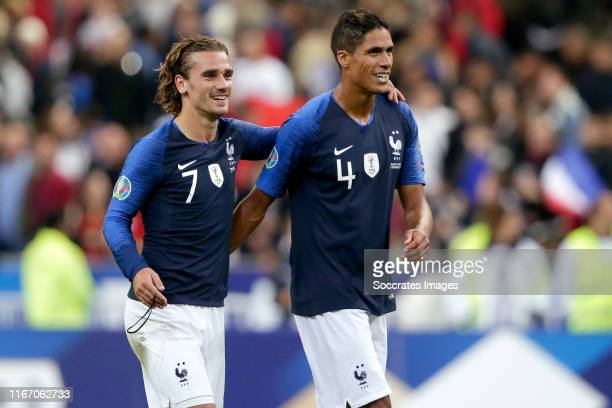 Antoine Griezmann of France, Raphael Varane of France celebrates the victory during the EURO Qualifier match between France v Albania at the Stade de...