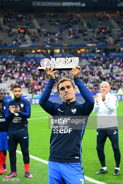 Antoine Griezmann of France receives the 'player of the tournament' award for the recent UEFA Euro 2016 before the 2018 Fifa World Cup qualifying...