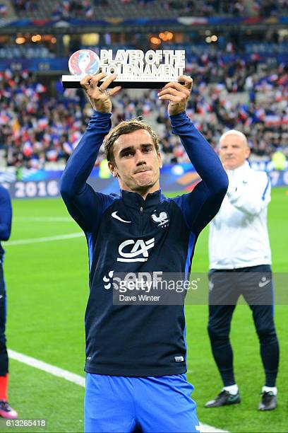 Antoine Griezmann of France receives the Player of the Tournament trophy for the recent UEFA Euro 2016 competition before the 2018 Fifa World Cup...