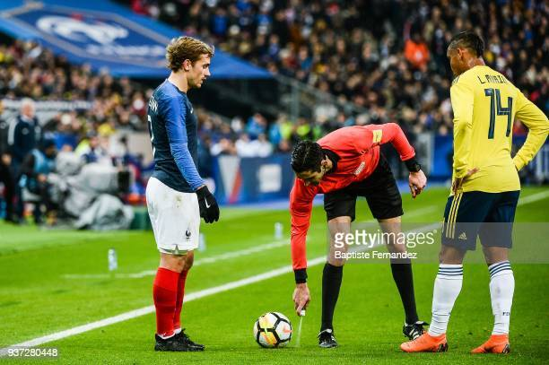 Antoine Griezmann of France Referee Adrien Jaccottet and Luis Fernando Muriel of Colombia during the International friendly match between France and...