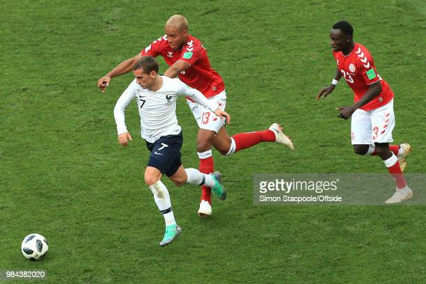 Antoine Griezmann of France runs away from Mathias Zanka Jorgensen of Denmark and Pione Sisto of Denmark during the 2018 FIFA World Cup Russia Group...