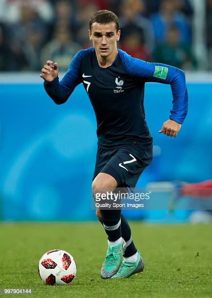 Antoine Griezmann of France runs with the ball during the 2018 FIFA World Cup Russia Semi Final match between Belgium and France at Saint Petersburg...