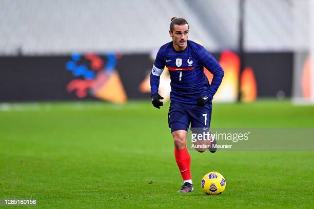 Antoine Griezmann of France runs with the ball during the international friendly match between France and Finland at Stade de France on November 11,...
