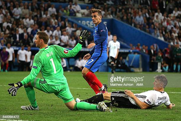 Antoine Griezmann of France scores a goal to make the score 02 during the UEFA Euro 2016 Semi Final match between Germany and France at Stade...