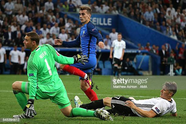 Antoine Griezmann of France scores a goal to make the score 0-2 during the UEFA Euro 2016 Semi Final match between Germany and France at Stade...