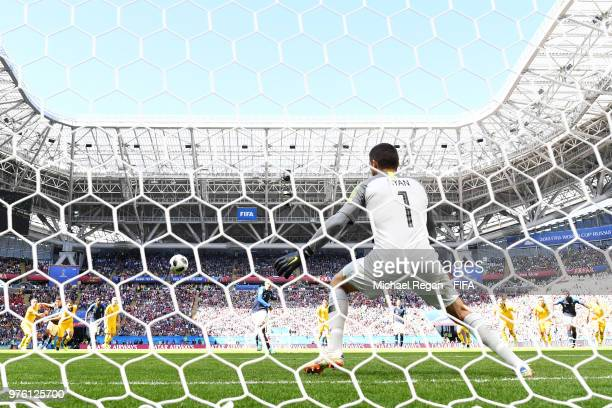 Antoine Griezmann of France scores a penalty for his team's first goal past Mathew Ryan of Australia during the 2018 FIFA World Cup Russia group C...