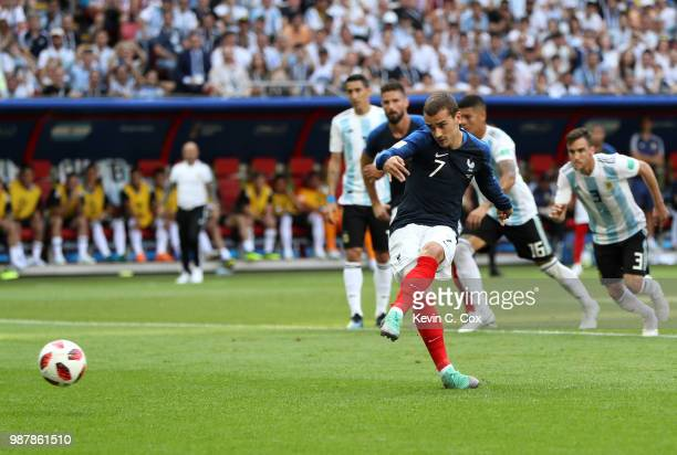 Antoine Griezmann of France scores a penalty his side's first goal during the 2018 FIFA World Cup Russia Round of 16 match between France and...
