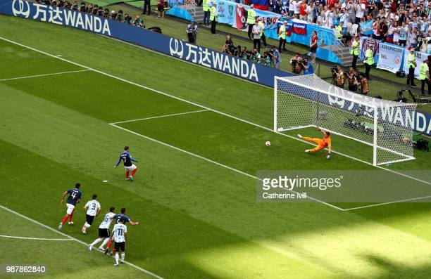 Antoine Griezmann of France scores a penalty his side's first goal past Franco Armani of Argentina during the 2018 FIFA World Cup Russia Round of 16...
