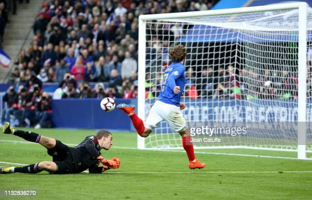 Antoine Griezmann of France scores his goal passing by goalkeeper of Iceland Hannes Thor Halldorsson during the 2020 UEFA European Championships...