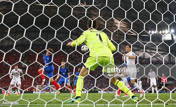 Antoine Griezmann of France scores his side's first goal past goalkeeper Etrit Berisha of Albania during the UEFA EURO 2016 Group A match between...