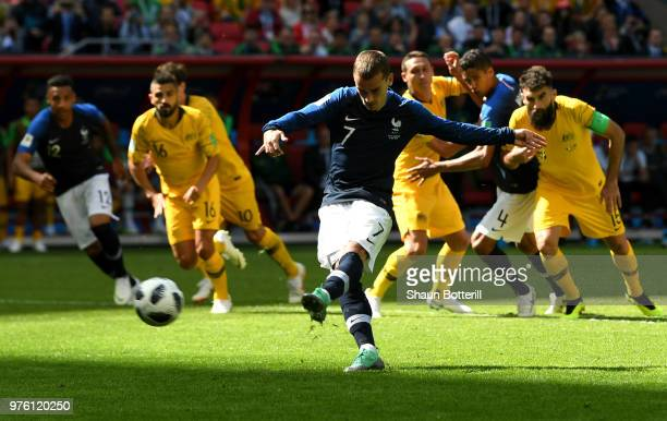 Antoine Griezmann of France scores his team's first goal from the penalty spot during the 2018 FIFA World Cup Russia group C match between France and...