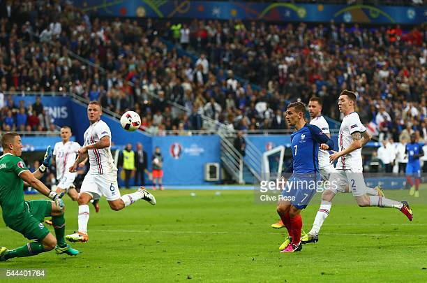 Antoine Griezmann of France scores his team's fourth goal past Hannes Halldorsson of Iceland during the UEFA EURO 2016 quarter final match between...