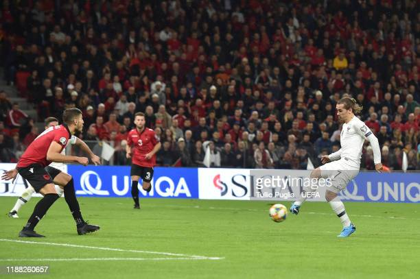 Antoine Griezmann of France scores his team's second goal during the UEFA Euro 2020 Qualifier between Albania and France at Arena Kombetare on...