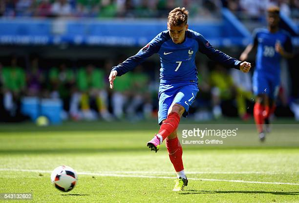 Antoine Griezmann of France scores his team's second goal during the UEFA EURO 2016 round of 16 match between France and Republic of Ireland at Stade...