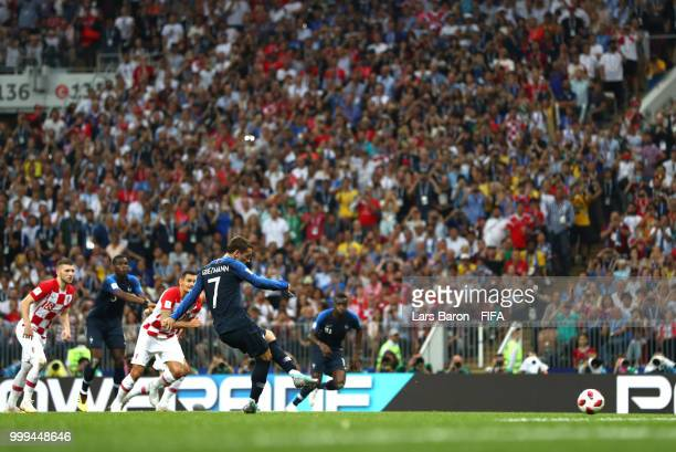 Antoine Griezmann of France scores his team's second goal from the penalty spot during the 2018 FIFA World Cup Final between France and Croatia at...