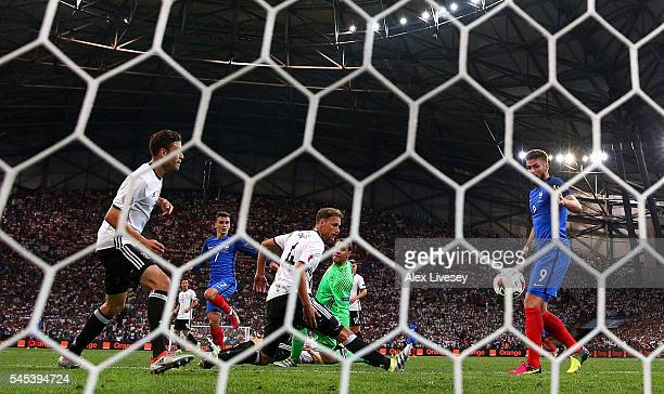 Antoine Griezmann of France scores his team's second goal past Manuel Neuer and Benedikt Hoewedes of Germany during the UEFA EURO semi final match...