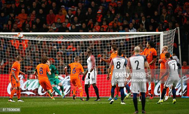 Antoine Griezmann of France scores the opening goal with a free kick during the International Friendly match between Netherlands and France at...