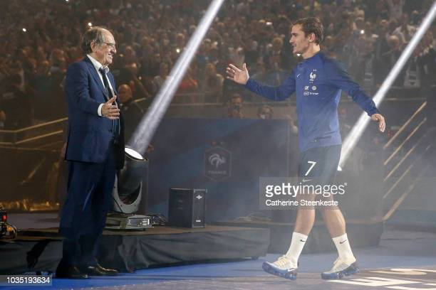 Antoine Griezmann of France shakes the hands of Noel Le Graet President of the French Football Federation during the celebration of the World Cup...