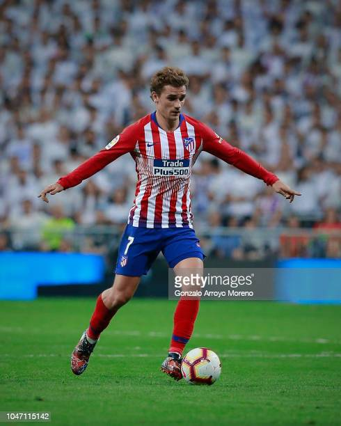 Antoine Griezmann of of Atletico de Madrid controls the ball during the La Liga match between Real Madrid CF and Club Atletico de Madrid at Estadio...