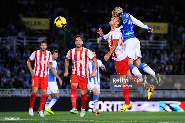 Antoine Griezmann of Real Sociedad de Futbol scores the opening goal past Rafael Ramos of UD Almeria during the La Liga match between Real Sociedad...
