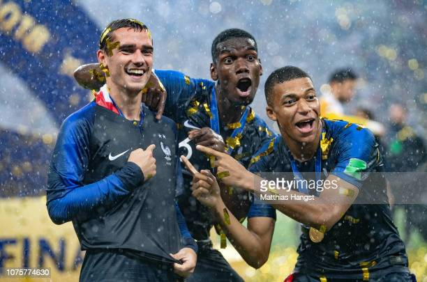 Antoine Griezmann Paul Pogba and Kylian Mbappe of France celebrate following their sides victory in the 2018 FIFA World Cup Final between France and...
