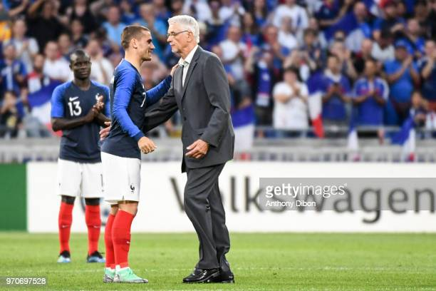 Antoine Griezmann shakes hand with Former France World Cup Winning coach Aime Jacquet during the International Friendly match between France and...