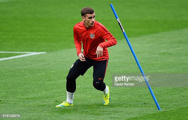 Antoine Griezmann sprints during an Atletico Madrid training session ahead of their UEFA Champions League quarter final first leg match against...