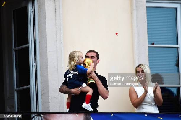 Antoine Griezmann with his daughter and Erika Choperena wife of Antoine Griezmann celebrates France victory in World Cup in his hometown on July 20...