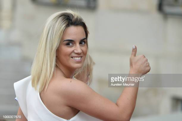 Antoine Griezmann's wife Erika Choperena arrives as French President Emmanuel Macron receives the France football team during a ceremony at the...