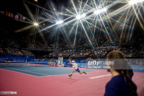 Antoine Hoang of France chases across the baseline to reach a shot from Jeremy Chardy of France during the Open Sud de France Tennis Tournament at...