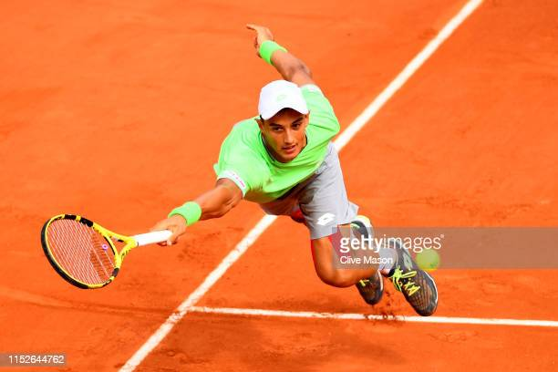Antoine Hoang of France plays a forehand during his mens singles second round match against Fernando Verdasco of Spain during Day five of the 2019...