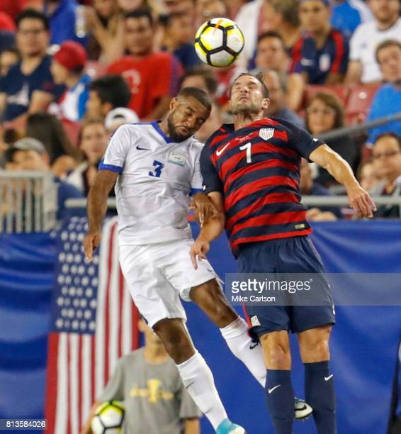 Antoine JeanBaptiste of Martinique and Chris Pontius of the United States go up for a ball during the second half of the CONCACAF Group B match at...