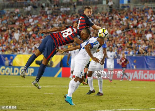 Antoine JeanBaptiste of Martinique heads the ball away from Juan Agudelo of the United States during the first half of the CONCACAF Group B match at...