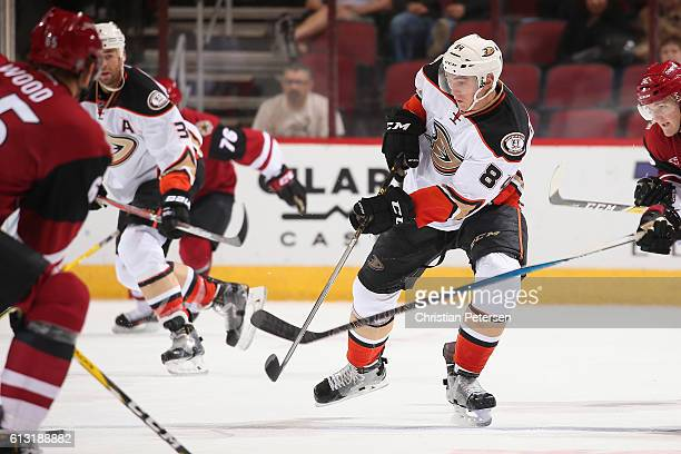 Antoine Laganiere of the Anaheim Ducks passes the puck during the preseason NHL game against Arizona Coyotes at Gila River Arena on October 1 2016 in...