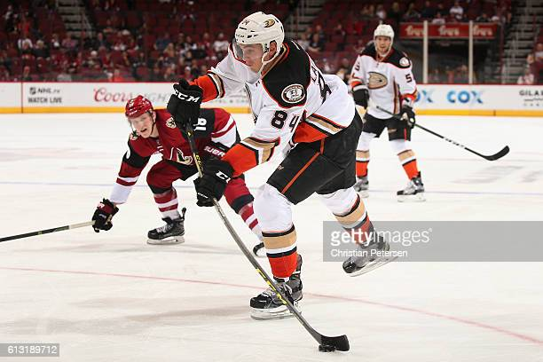 Antoine Laganiere of the Anaheim Ducks skates with the puck during the preseason NHL game against Arizona Coyotes at Gila River Arena on October 1...