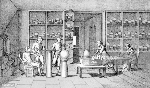 Antoine Laurent Lavoisier working on respiration experiment his wife Marie Paulze taking notes at right