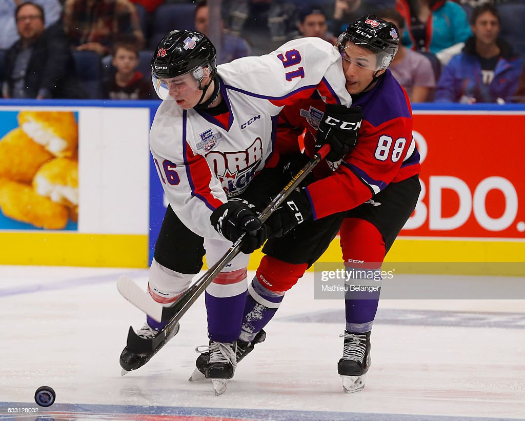 Antoine Morand #88 of Team Cherry and Kole Lind #16 of Team Orr battle for the puck during the third period of their Sherwin-Williams CHL/NHL Top Prospects Game at the Videotron Center on January 30, 2017 in Quebec City, Quebec, Canada.