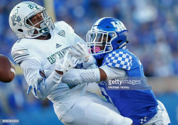 Antoine Porter of the Eastern Michigan Eagles has a pass broken up by Mike Edwards of the Kentucky Wildcats at Commonwealth Stadium on September 30...