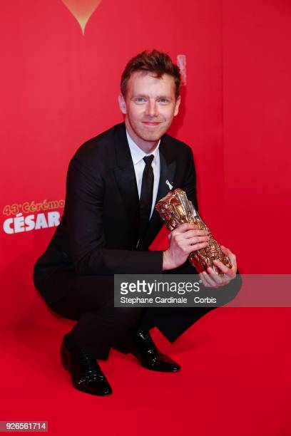 Antoine Reinartz poses with the Cesar award for Best Supporting Actor for '120 Battements par minute' during the Cesar Film Awards at Salle Pleyel on...