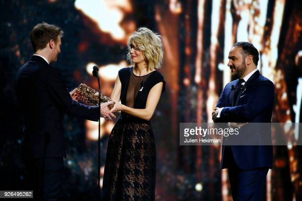 Antoine Reinartz receives from Laurence Arne and FrancoisXavier Demaison the best actor in a supporting role Award for the movie '120 battements par...