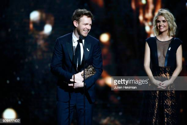 Antoine Reinartz receives from Laurence Arne the best actor in a supporting role Award for the movie 120 BPM during the Cesar Film Awards 2018 at...