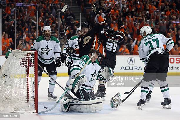 Antoine Roussel and goaltender Kari Lehtonen of the Dallas Stars look on as Corey Perry and Matt Beleskey of the Anaheim Ducks celebrate a goal by...