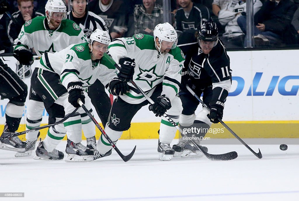Antoine Roussel #21 and Vernon Fiddler #38 of the Dallas Stars and Anze Kopitar #11 of the Los Angeles Kings race for the puck at Staples Center on November 13, 2014 in Los Angeles, California.