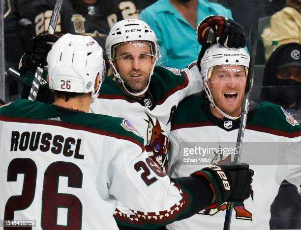 Antoine Roussel, Andrew Ladd and Travis Boyd of the Arizona Coyotes celebrate Ladd's third-period goal against the Vegas Golden Knights during their...