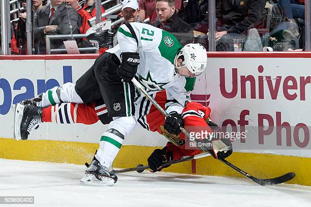 Antoine Roussel of the Dallas Stars hits Rob Scuderi of the Chicago Blackhawks in the second period of the NHL game at the United Center on February...