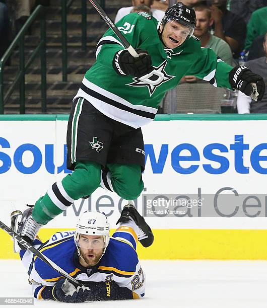 Antoine Roussel of the Dallas Stars jumps over Alex Pietrangelo of the St Louis Blues in the first period at American Airlines Center on April 3 2015...